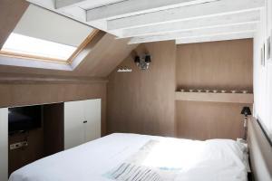 Un ou plusieurs lits dans un hébergement de l'établissement Les Maisons de la Mer