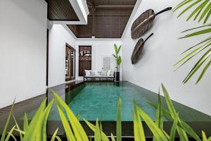 The swimming pool at or near 137 Pillars House