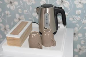 Coffee and tea making facilities at Bed and Breakfast Loft24