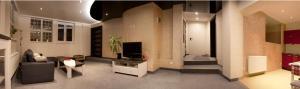 Telewizja i/lub zestaw kina domowego w obiekcie Kapart Home