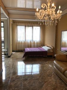 Кровать или кровати в номере Роза