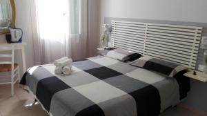A bed or beds in a room at Su per i Coppi
