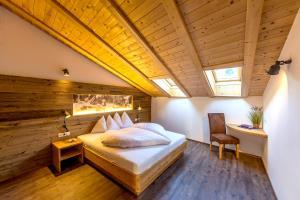 Letto o letti in una camera di Dolomite Apartments Winklwiese
