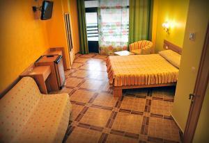 Кровать или кровати в номере Zolotoye Runo