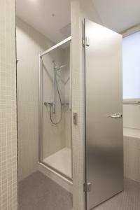 Ein Badezimmer in der Unterkunft Hotel Alpha
