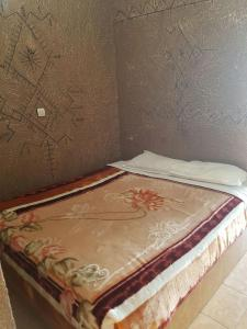 A bed or beds in a room at Residence Tafat