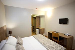 Cama ou camas em um quarto em Marano Hotel