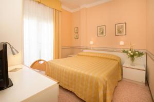Letto o letti in una camera di Hotel Morchio