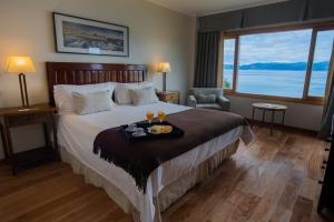 A bed or beds in a room at Los Cauquenes Resort + Spa + Experiences