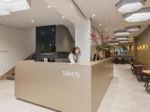 The lobby or reception area at Hotel Savoy
