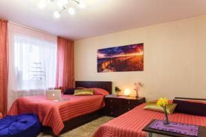 """Кровать или кровати в номере Апартаменты """"На Молодежной"""" с балконом"""