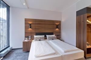 A bed or beds in a room at Arthotel ANA Diva