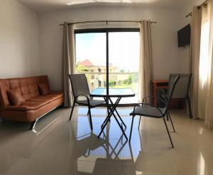 Ein Sitzbereich in der Unterkunft Luxe Exotica Apartment