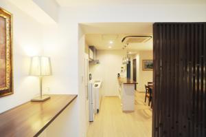 A kitchen or kitchenette at Sakura