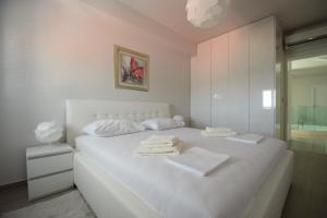 Letto o letti in una camera di Apartments Lofiel
