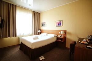 Кровать или кровати в номере City Hotel Bishkek