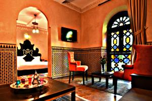 A seating area at Palais Ommeyad Suites & Spa