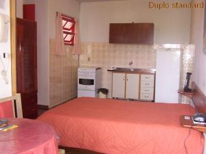 A cozinha ou cozinha compacta de Residencial Sol e Mar de Floripa