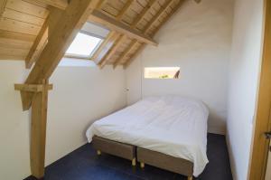 Een bed of bedden in een kamer bij Eyndevelde