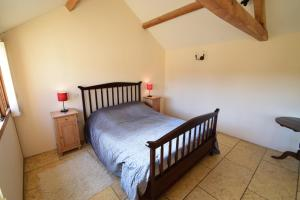 A bed or beds in a room at The Warren - Ash Farm Cotswolds