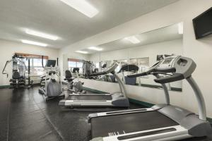 The fitness center and/or fitness facilities at Country Inn & Suites by Radisson, Kansas City at Village West, KS