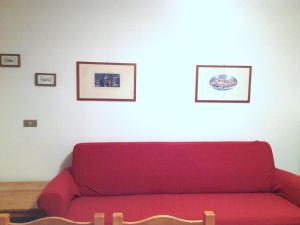 A seating area at Lovely Holiday Home near Pozza di Fassa with Garden