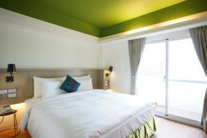 陽光士林珮柏旅館房間的床