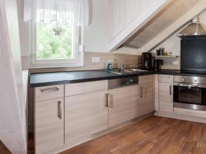 Küche/Küchenzeile in der Unterkunft Classy Holiday Home in Thale with Terrace