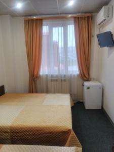 Кровать или кровати в номере Гостевой Дом Долина