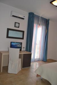 TV o dispositivi per l'intrattenimento presso Hotel La Siesta