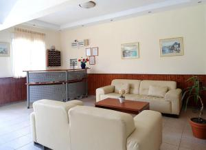 The lobby or reception area at Vourvourou Hotel