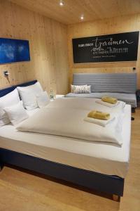 Ein Bett oder Betten in einem Zimmer der Unterkunft mein kleinHOTEL