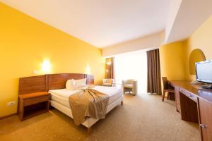 Un pat sau paturi într-o cameră la Hotel Parc