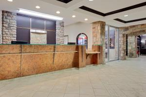 The lobby or reception area at Ramada by Wyndham Stettler