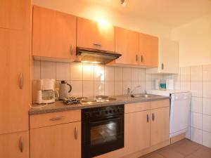A kitchen or kitchenette at Beautiful Holiday Home in Heppenbach with Garden