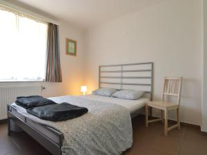 A bed or beds in a room at Beautiful Holiday Home in Heppenbach with Garden