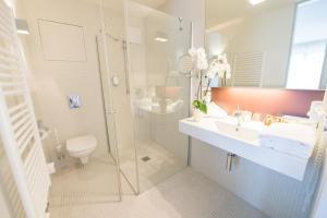 Ein Badezimmer in der Unterkunft Nymphe Strandhotel & Apartments