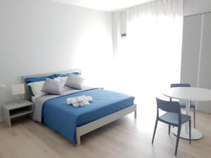 Letto o letti in una camera di Trani Rent Rooms