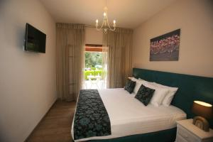 A bed or beds in a room at Summer Wine Friendly Resort