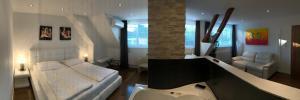 Ein Sitzbereich in der Unterkunft Hotel Restaurant Pusswald