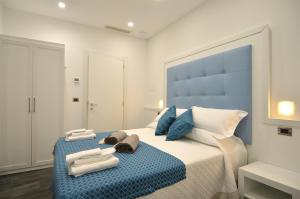 A bed or beds in a room at Fronte Mare
