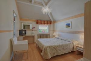 Een bed of bedden in een kamer bij Hotel Europa