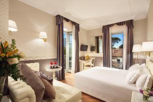 Кровать или кровати в номере Grand Hotel Imperiale Resort & SPA