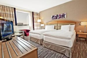 A bed or beds in a room at Hilton Sofia
