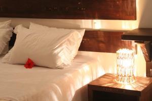 Cama ou camas em um quarto em Pousada Topázio
