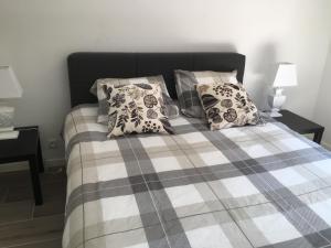 Ein Bett oder Betten in einem Zimmer der Unterkunft Apartment Beach