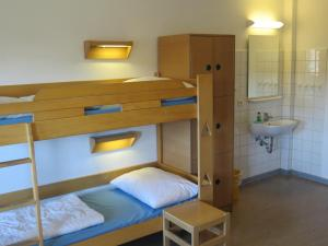 A bunk bed or bunk beds in a room at Jugendherberge List