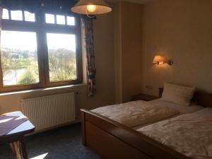 Een bed of bedden in een kamer bij Hotel Raatz
