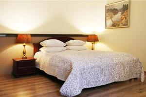 """A bed or beds in a room at Old Riga Boutique Hotel """"Vecriga"""""""