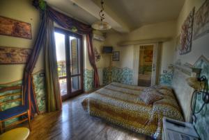 Letto o letti in una camera di B&B Qui Dormì L'Etrusco
